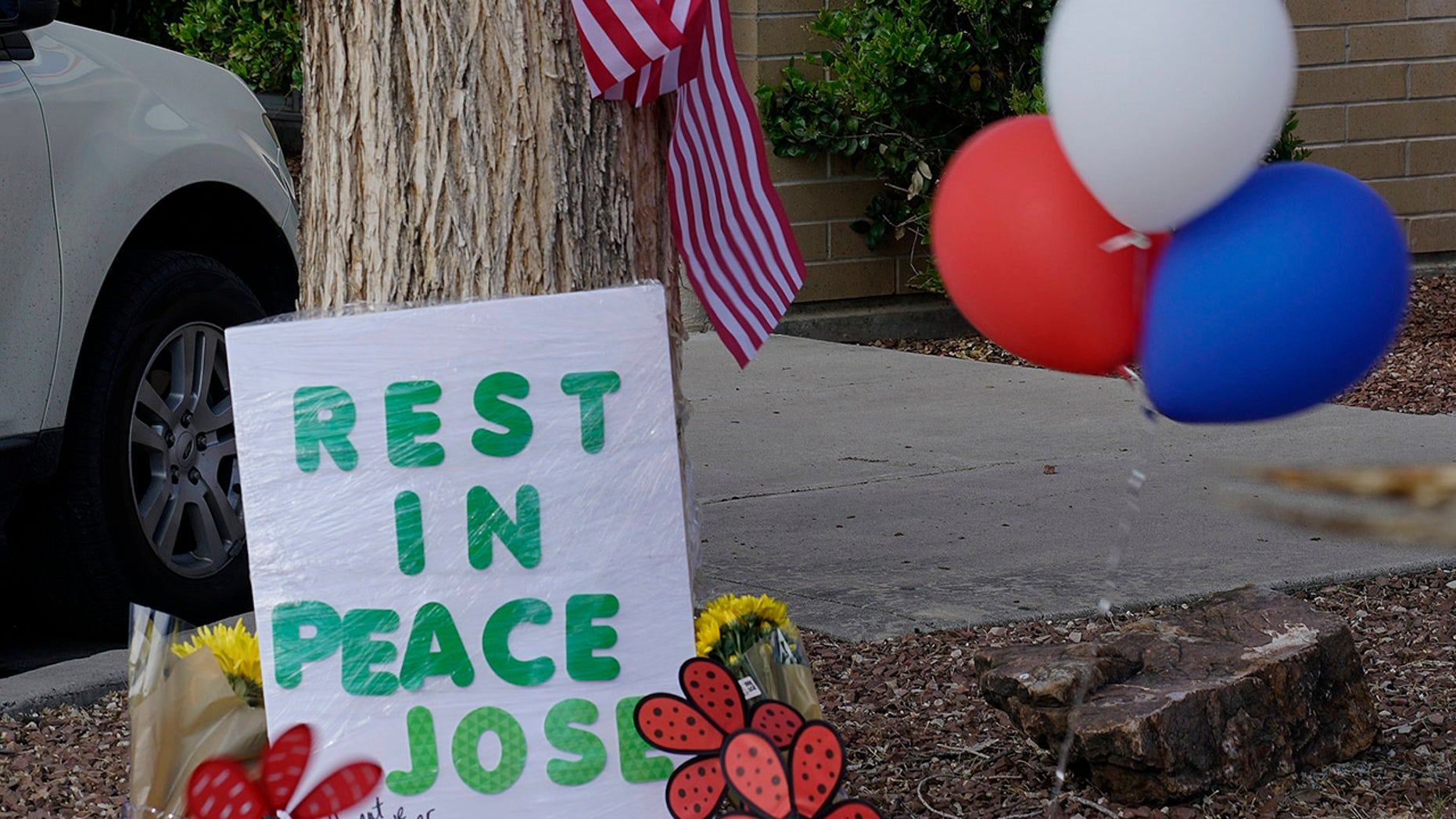 A makeshift memorial in honor of the mail carrier fatally shot Monday in Southwest Albuquerque, New Mexico is seen in front of the Five Points Postal Station, photographed on April 23, 2019. (Associated Press)