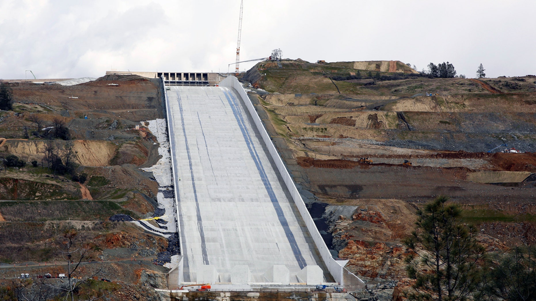 Water flows down California dam's rebuilt spillway after