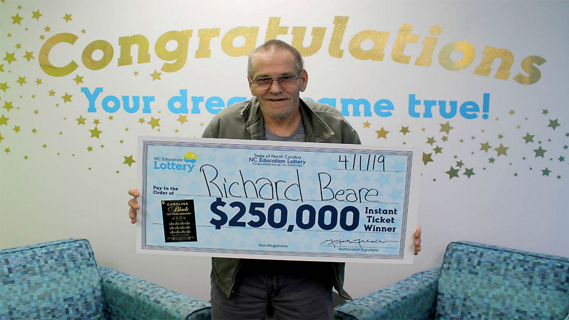Richard Beare collected his big prize from the winning scratch-off ticket Monday.