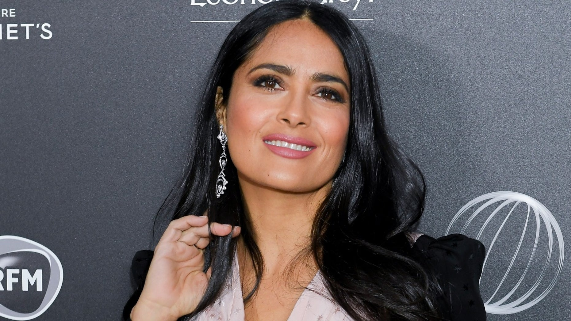 """Actress Salma Hayek gave fans a sneak peek of her secret tattoo as part of her character in the upcoming film """"The Hitman's Wife's Bodyguard."""""""