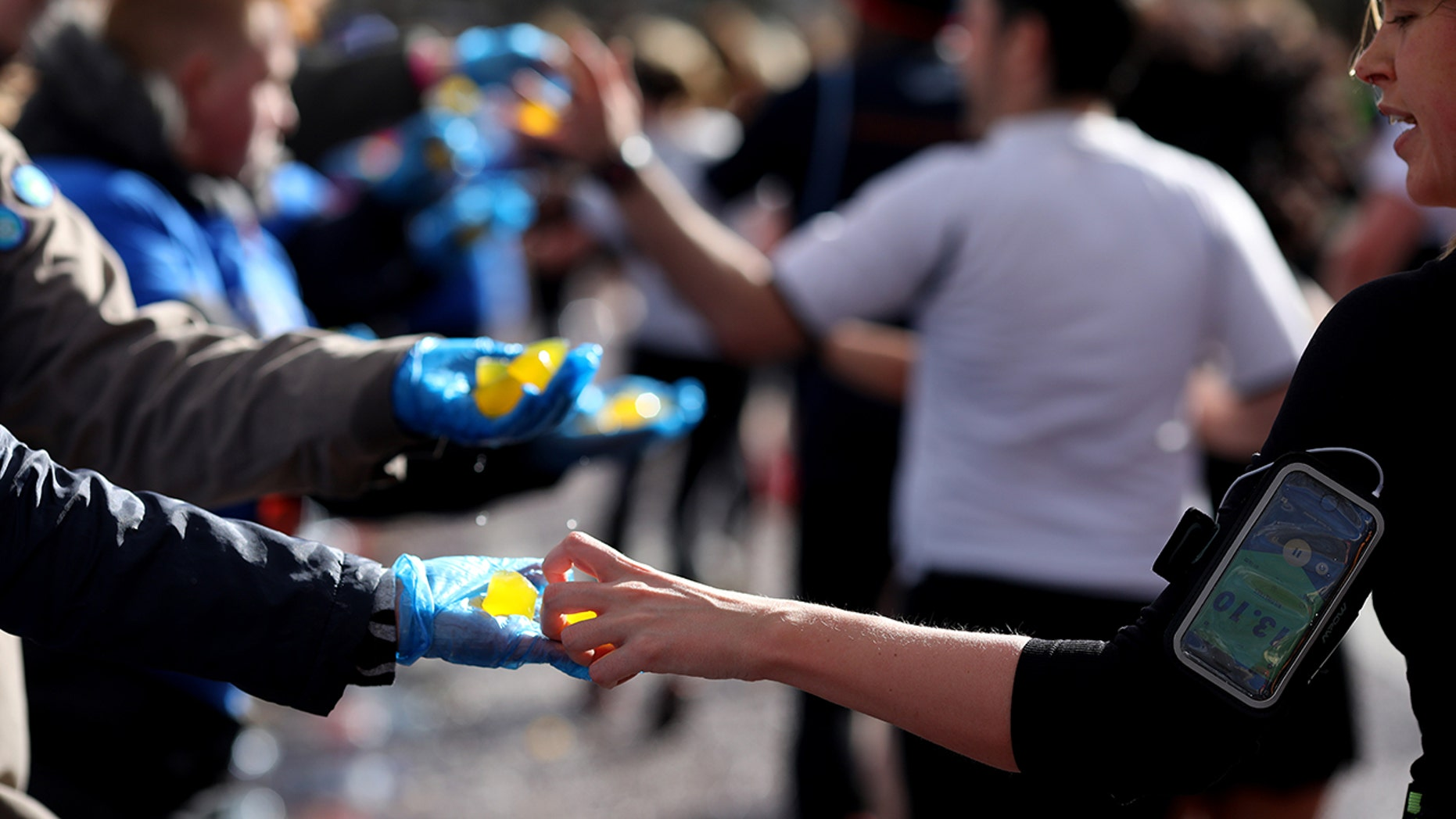 Competitors grab edible seaweed capsules during the Vitality Big Half on March 10 in London. (Photo by Charlie Crowhurst/Getty Images for Lucozade Sport)