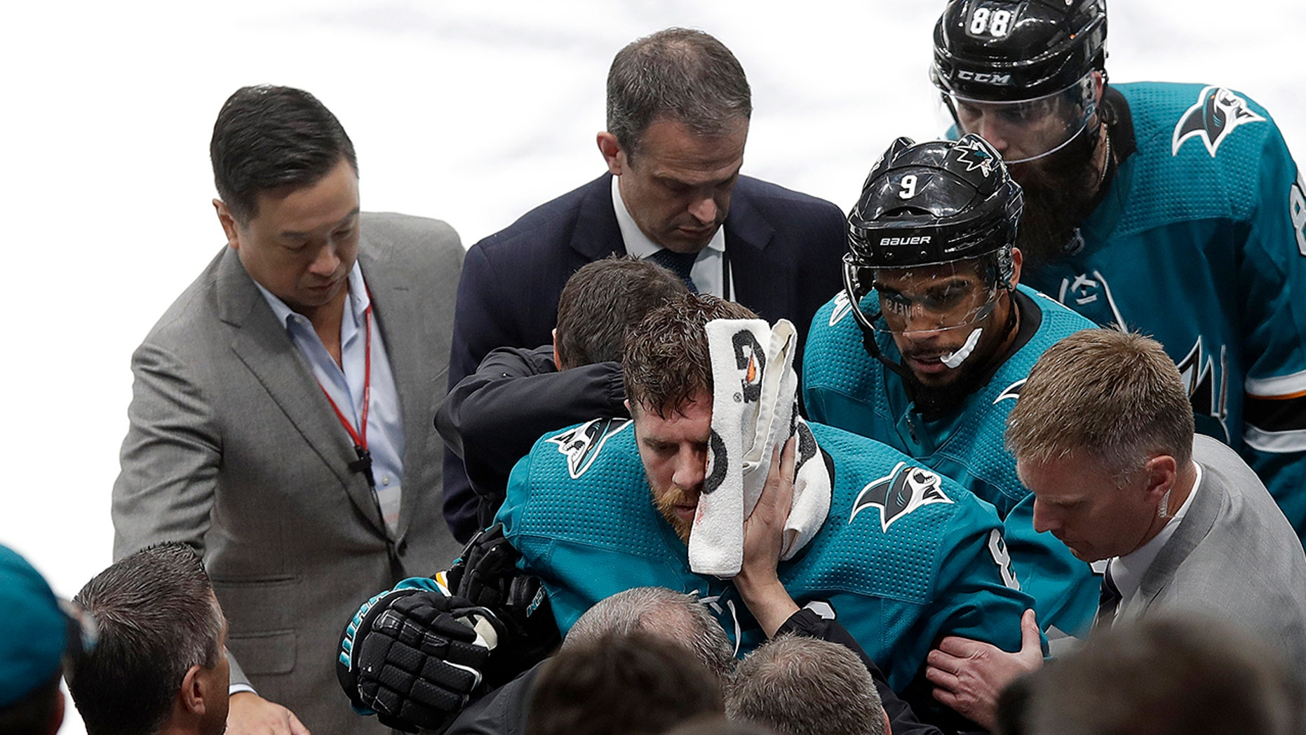 San Jose Sharks center Joe Pavelski, bottom center, is helped off the ice during the third period of Game 7 of an NHL hockey first-round playoff series against the Vegas Golden Knights in San Jose, Calif., Tuesday, April 23, 2019. (Associated Press)