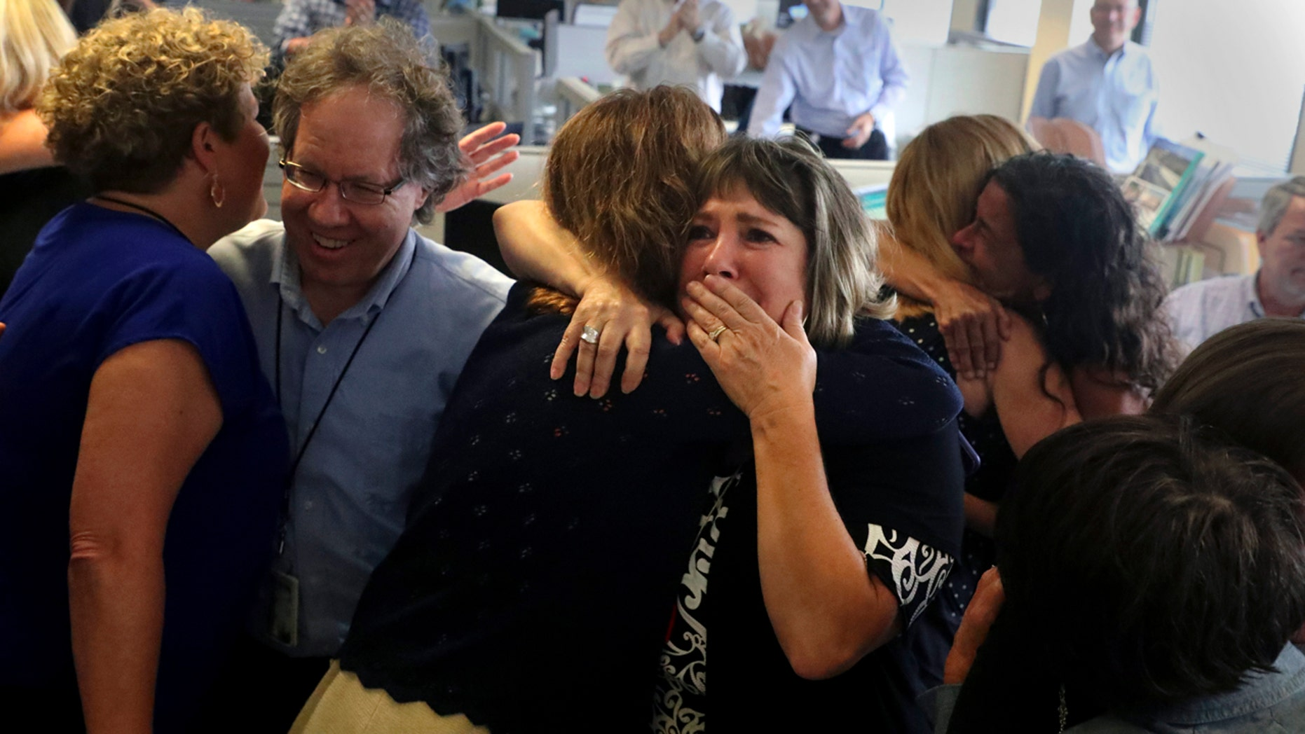 South Florida Sun Sentinel staffers react after winning the Pulitzer Prize for Public Service Monday for its coverage of the Parkland school shooting. (Carline Jean/South Florida Sun-Sentinel via AP)