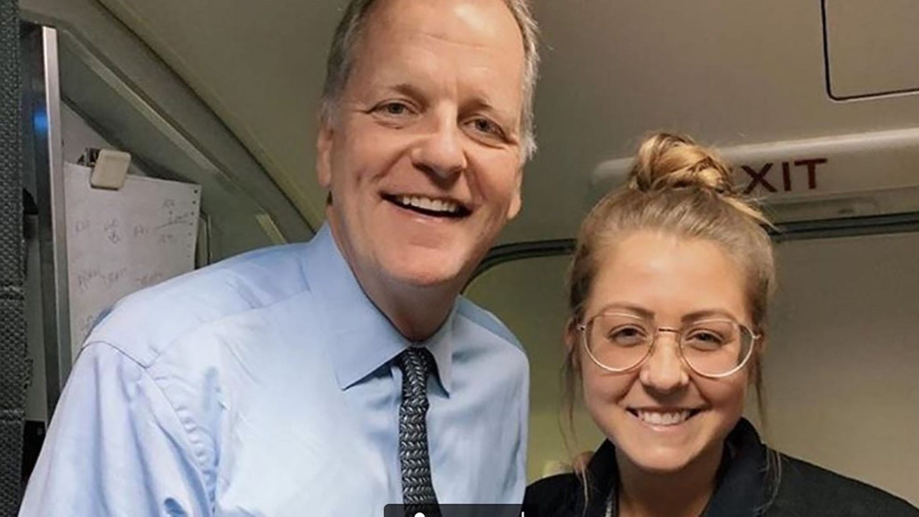 American Airlines CEO Doug Parker (left) with flight attendant Maddie Peters.