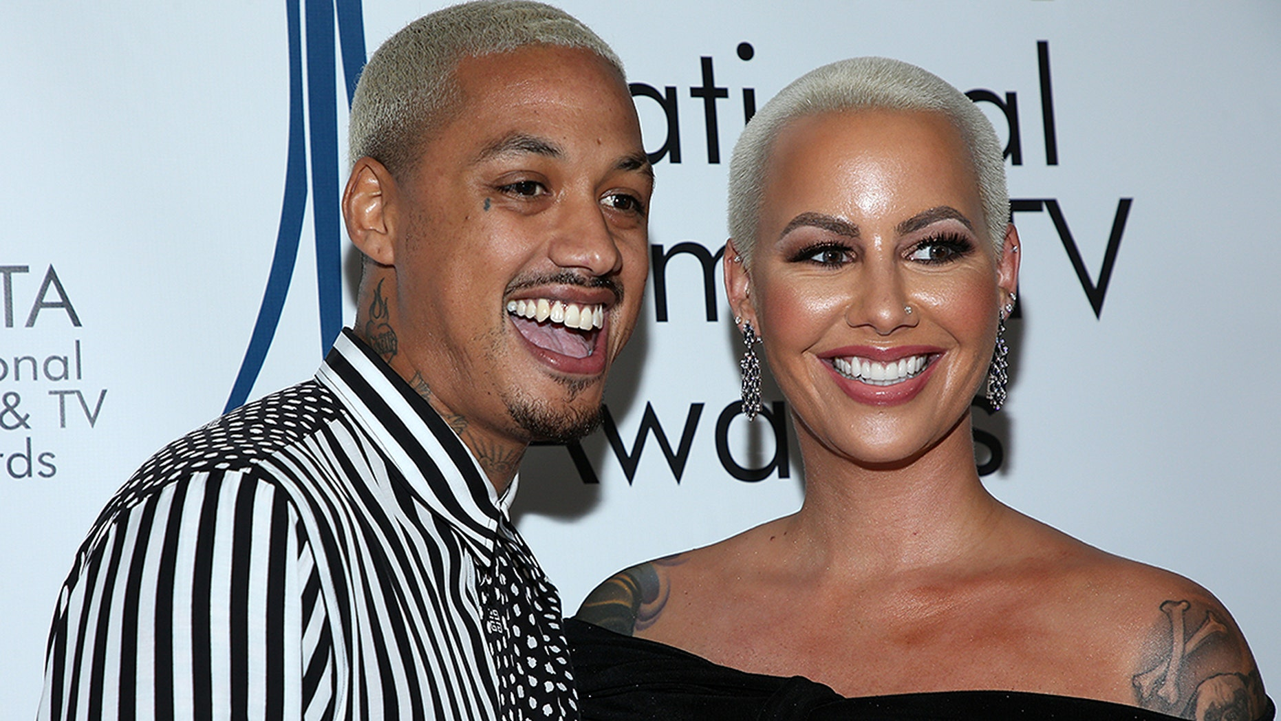 """Alexander """"AE"""" Edwards and Amber Rose attend the National Film and Television Awards Ceremony at the Globe Theatre on Dec. 5, 2018 in Los Angeles."""