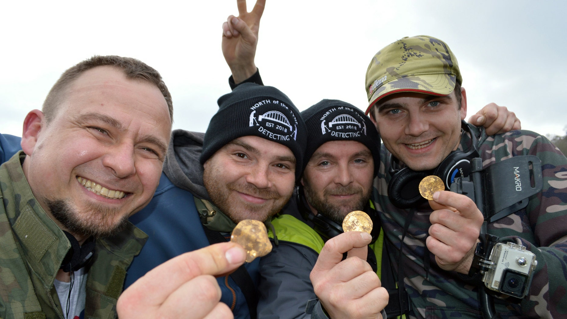 Dariusz Fijalkowski , Mateusz Nowak, Andrew Winter, Tobiasz Nowak. Four amateur metal detectorists have uncovered a hoard of 14th-century coins in a field in Hambleden, Buckinghamshire- worth an estimated £150,000. (Credit: SWNS)