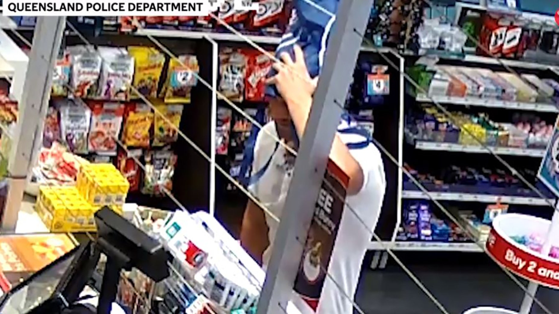 CCTV footage showed a man rob a gas station in Australia with a reusable shopping bag over his head, police said.