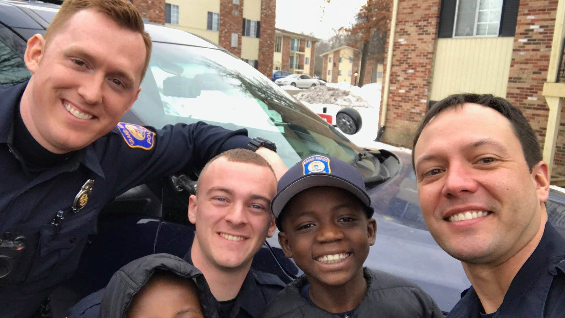Grand Rapids police officers helped 9-year-old Thomas Daniel celebrate his birthday after no one showed up to his party.