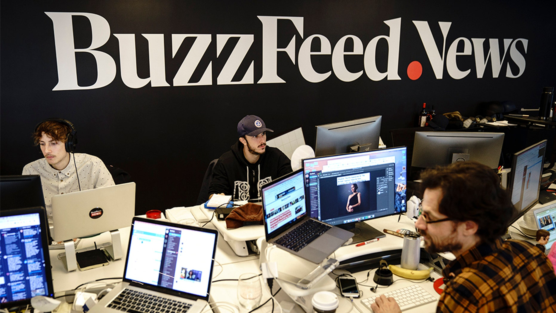 NEW YORK, NY - BuzzFeed is dropping out of the White House travel pool. Members of the BuzzFeed News team are seen at their desks at BuzzFeed headquarters, December 11, 2018 in New York City. (Photo by Drew Angerer/Getty Images)
