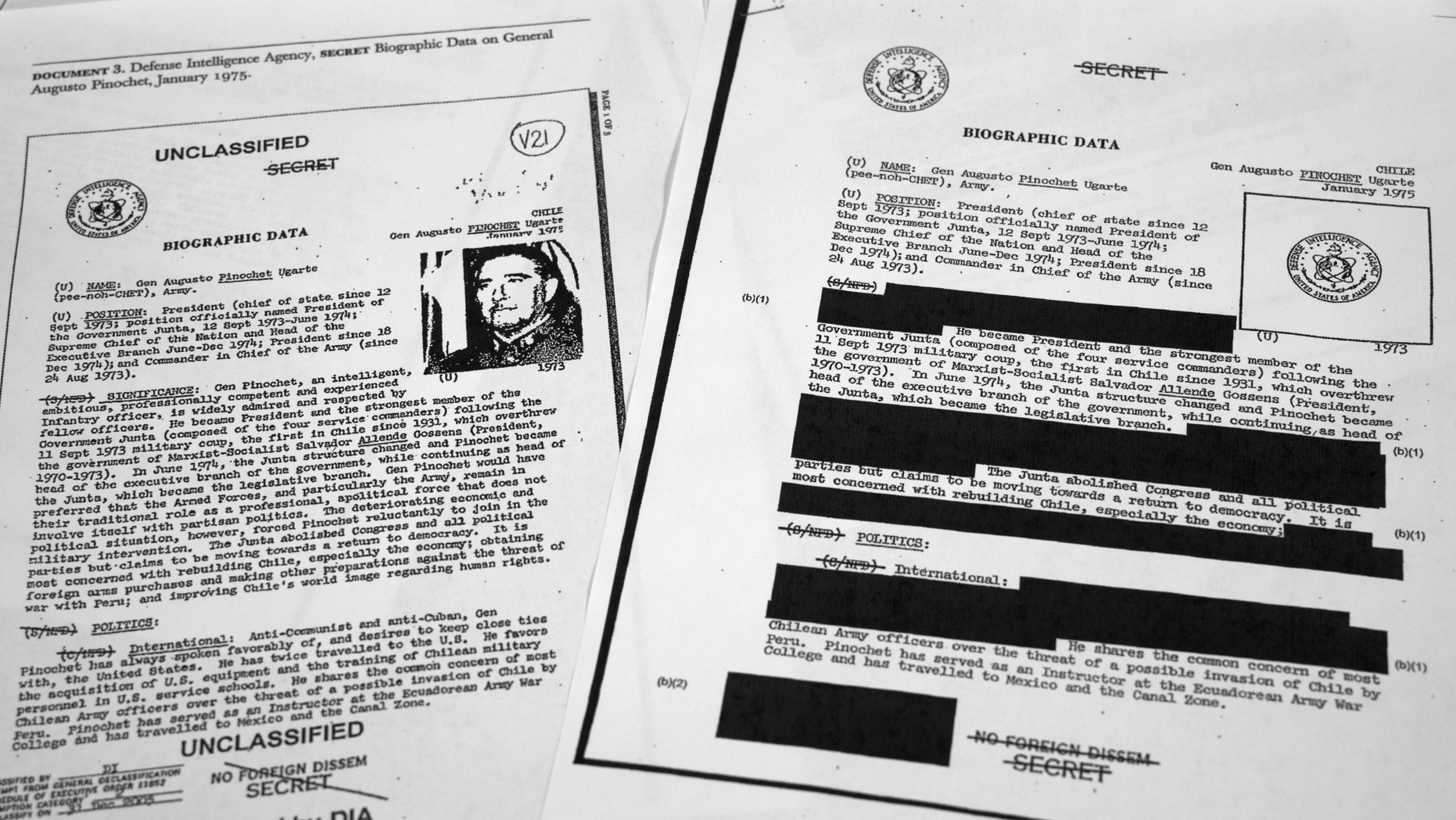 "The redacted, right, and the unredacted versions of the biographical intelligence file report on Chilean dictator Augusto Pinochet from 1975 is photographed on April 15, 2019, in Washington. In 2003, the Defense Intelligence Agency declassified the documents that included a biographical sketch of Pinochet. Attorney General William Barr's announcement that he would release a ""redacted"" version of Mueller's findings will likely set off a long debate over what's behind the darkened patches. (AP Photo/Jon Elswick)"