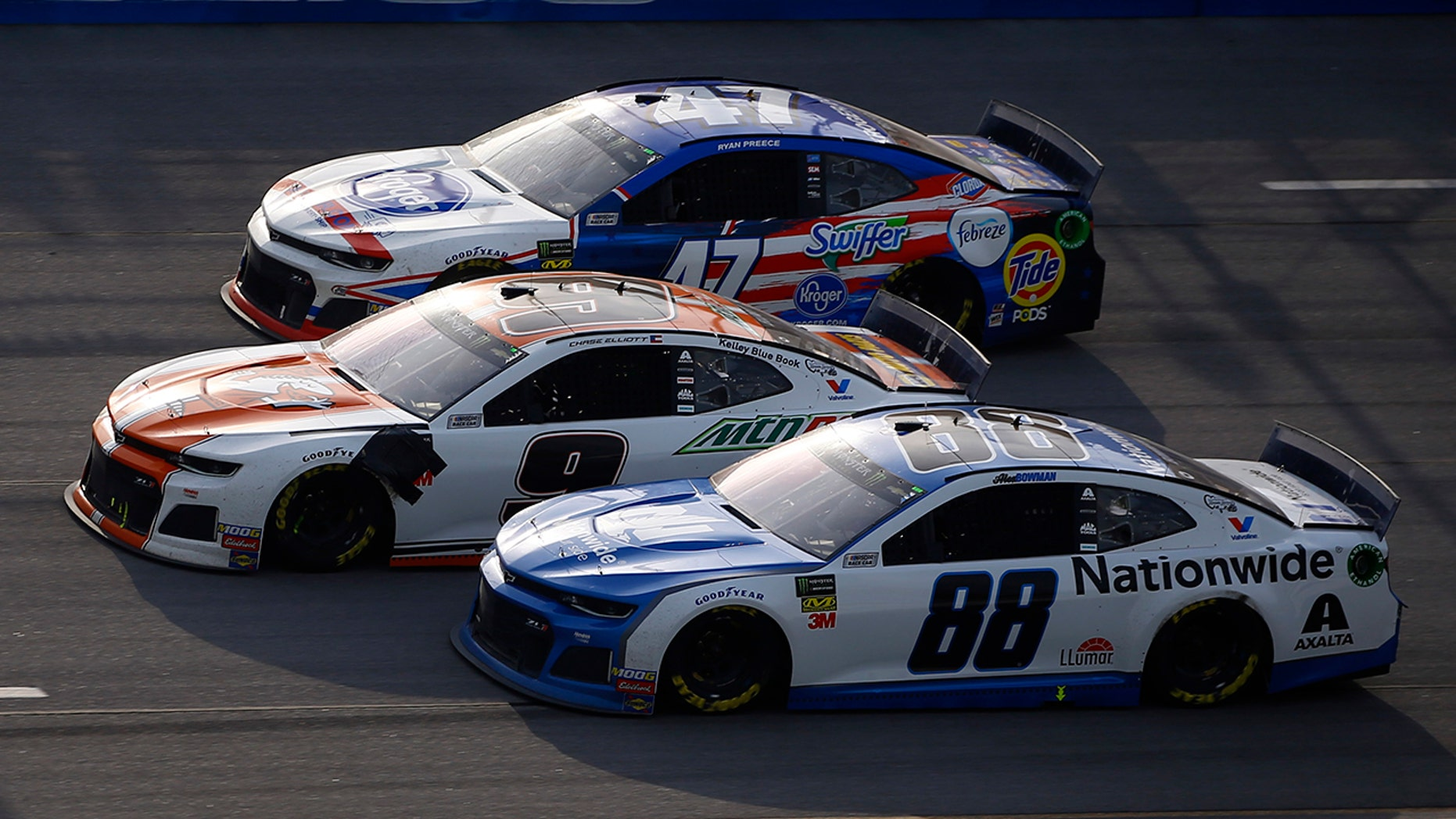 Chase Elliott (9) leads Alex Bowman (88) and Ryan Preece (47) to a finish line to win a NASCAR Cup Series automobile competition during Talladega Superspeedway, Sunday, Apr 28, 2019, in Talladega, Ala.