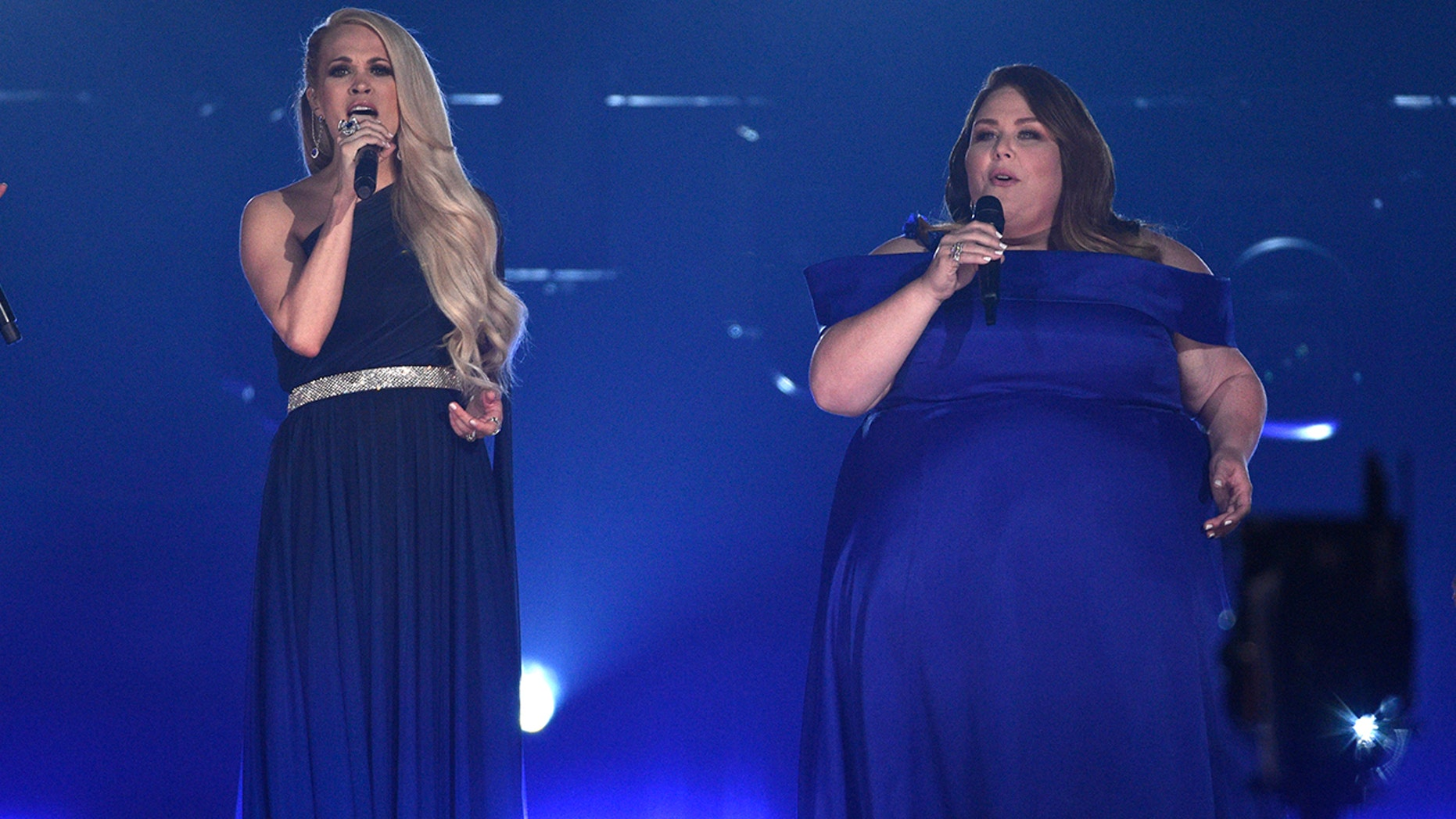 Carrie Underwood, left, and Chris Mets perform