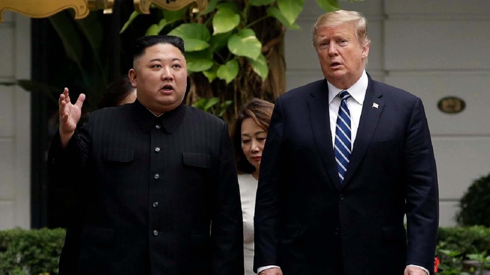 President Trump and North Korean leader Kim Jong Un take a walk after their first meeting at the Sofitel Legend Metropole Hanoi hotel, in Hanoi in February. (Associated Press)