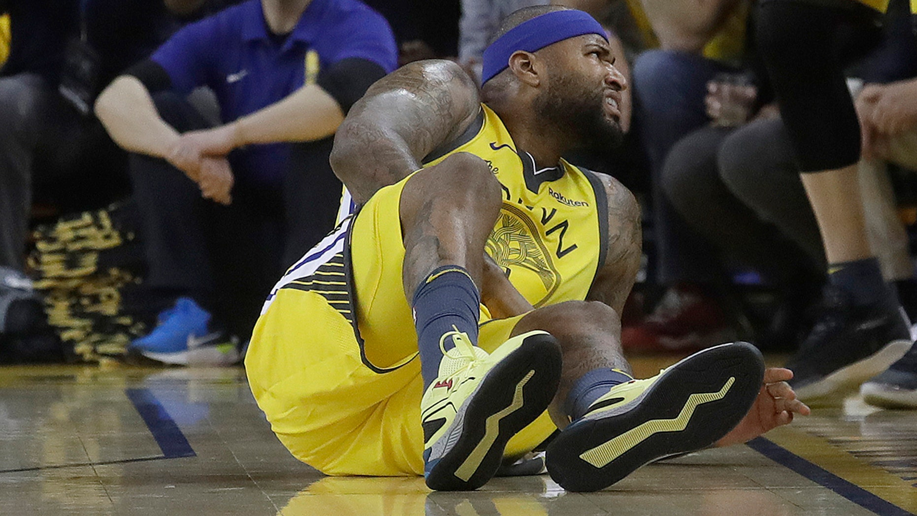 Golden State Warriors center DeMarcus Cousins reacts after falling to the floor during the first half of Game 2 of a first-round NBA basketball playoff series against the Los Angeles Clippers in Oakland, Calif., on Monday. (AP Photo/Jeff Chiu)