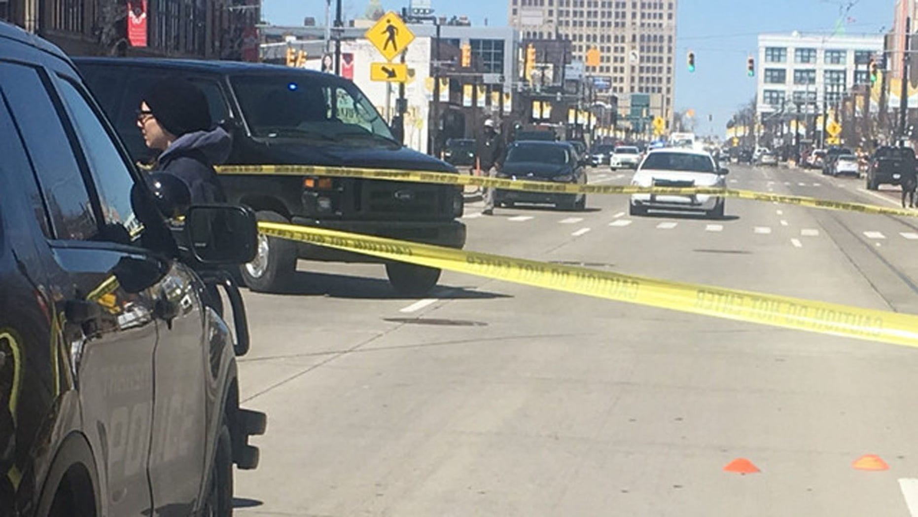 A man was shot in the face and shoulder after a argument on a bus in Detroit over some gym shoes, according to police.