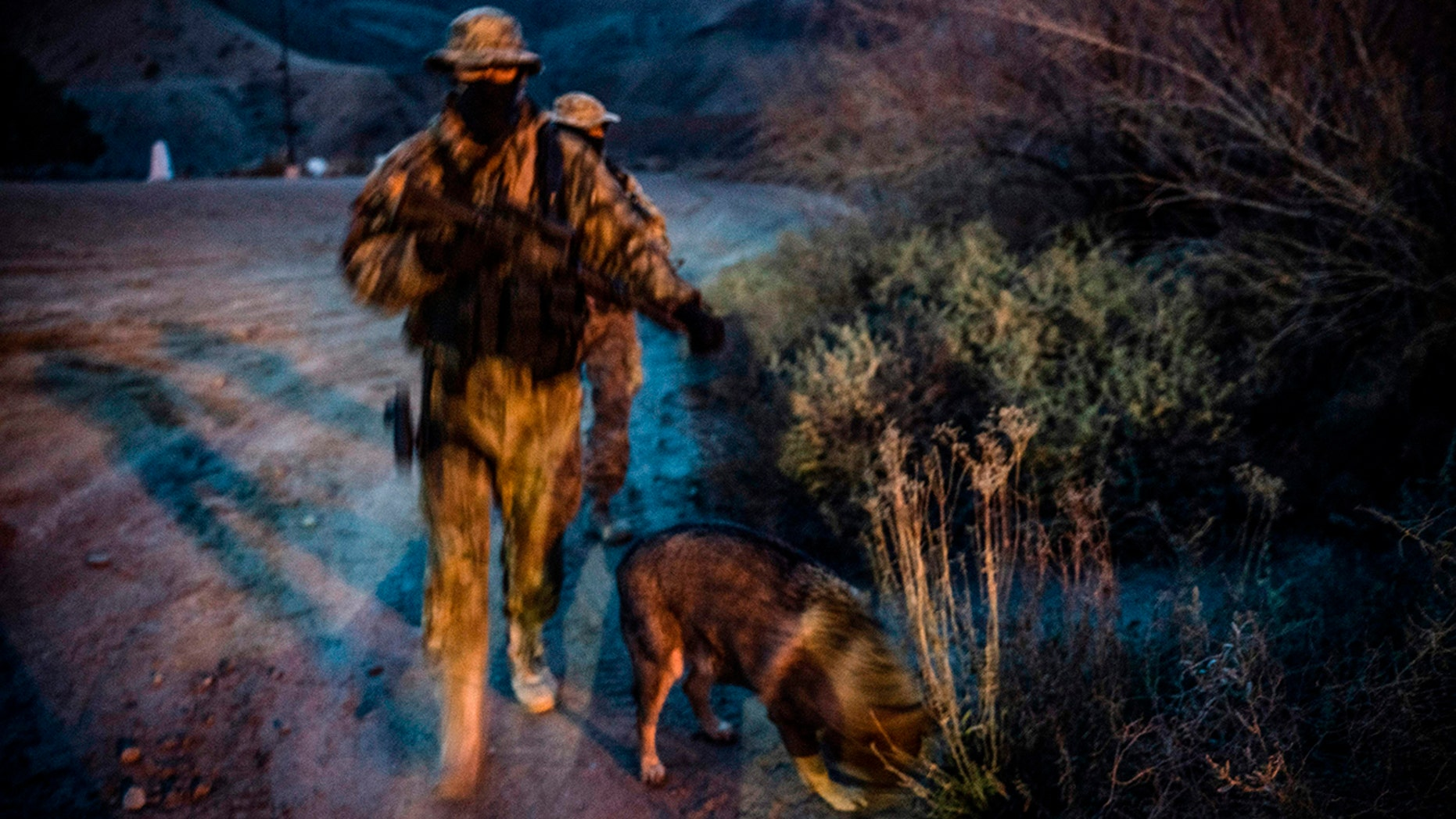 FILE 2019: Members of the Constitutional Patriots New Mexico Border Ops Team militia, Viper and Stinger who go by aliases to protect their identity, patrol the US-Mexico border in Sunland Park, New Mexico.