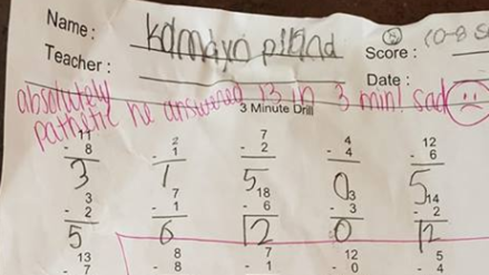 A Pennsylvania father shared an image of his son's math assignment with harsh comments written on top.