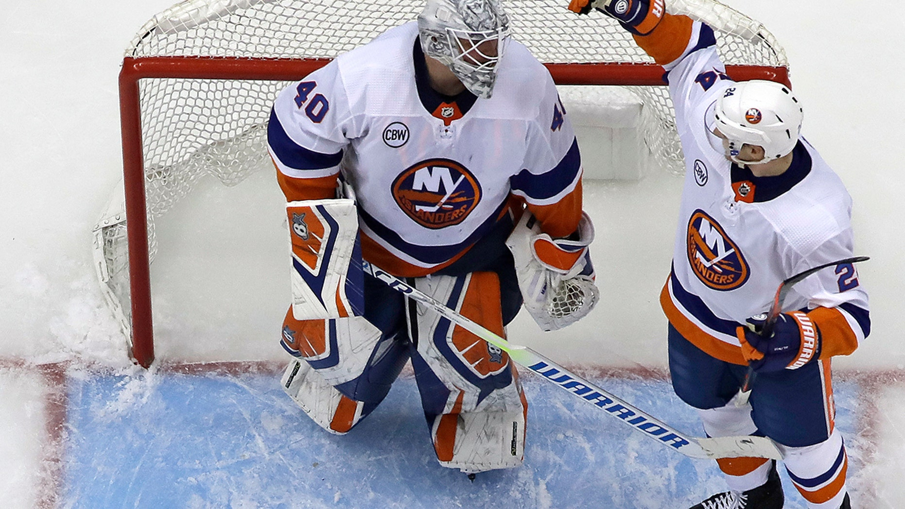 New York Islanders goaltender Robin Lehner, left, celebrates with Scott Mayfield (24) after a win over the Pittsburgh Penguins in Game 3 of an NHL first-round hockey playoff series in Pittsburgh, Sunday, April 14, 2019. (AP Photo/Gene J. Puskar)