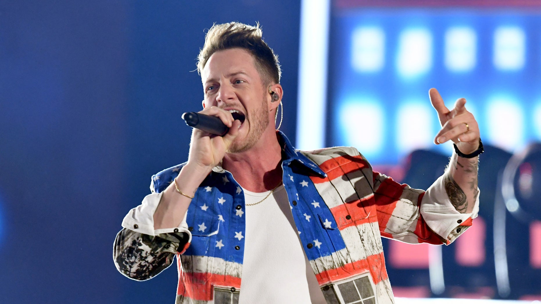 Florida Georgia Line's Tyler Hubbard, wearing an American flag jacket and jeans, performs at the 2019 ACM Awards in Las Vegas.