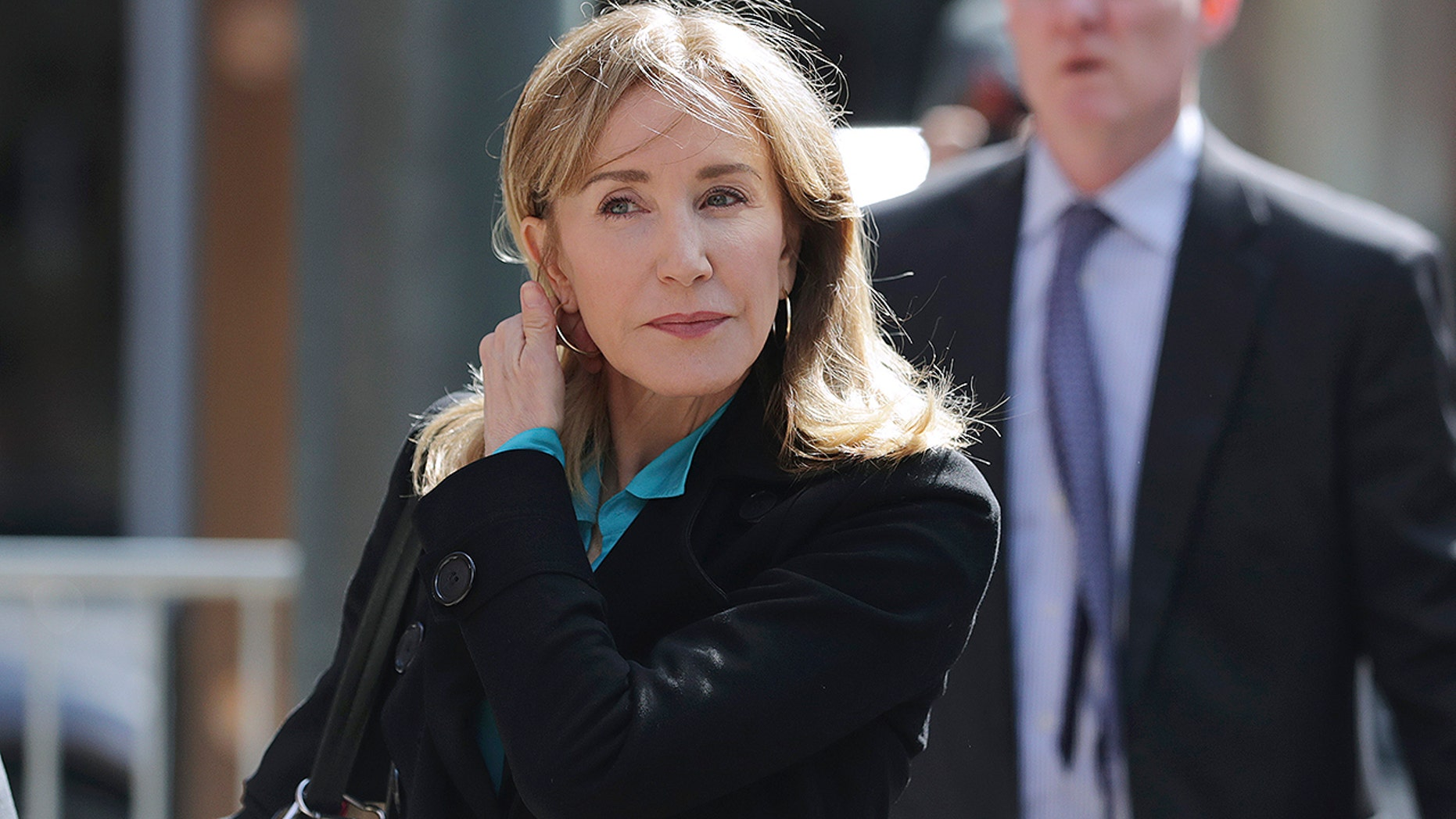 Actress Felicity Huffman arrives at federal court in Boston on Wednesday, April 3, 2019, to face charges in a nationwide college admissions bribery scandal. (Associated Press)