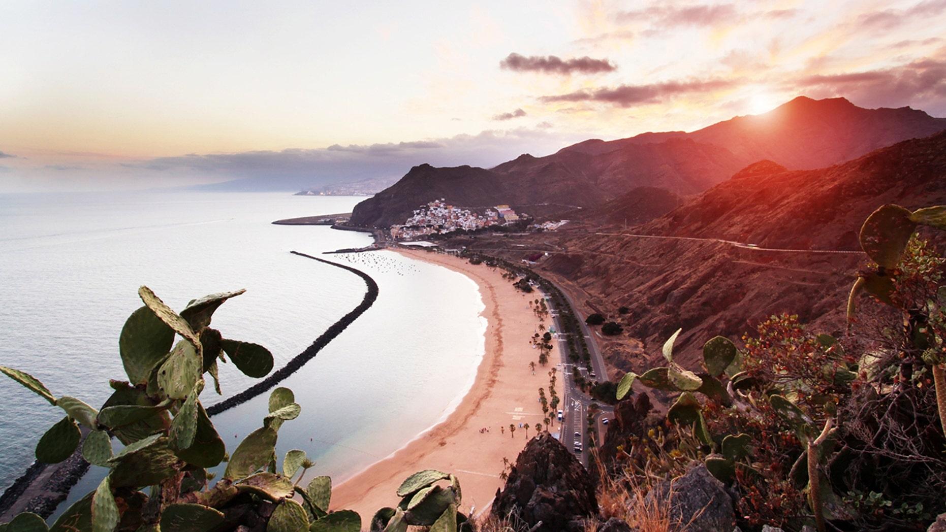 View of Playa de Las Teresitas, Sant Andres and Santa Cruz de Tenerife at sunset.