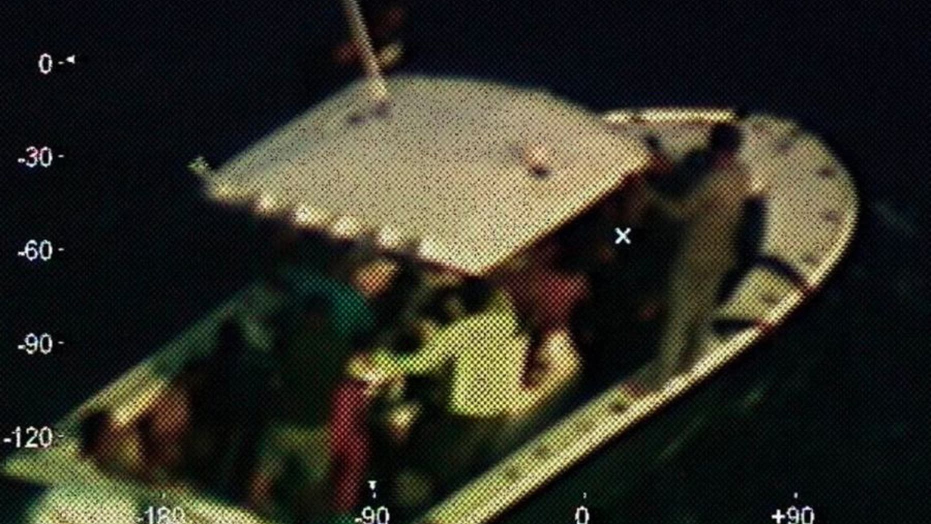 A photograph shows the disabled vessel 130 nautical miles from the Yucatan Peninsula of Mexico.