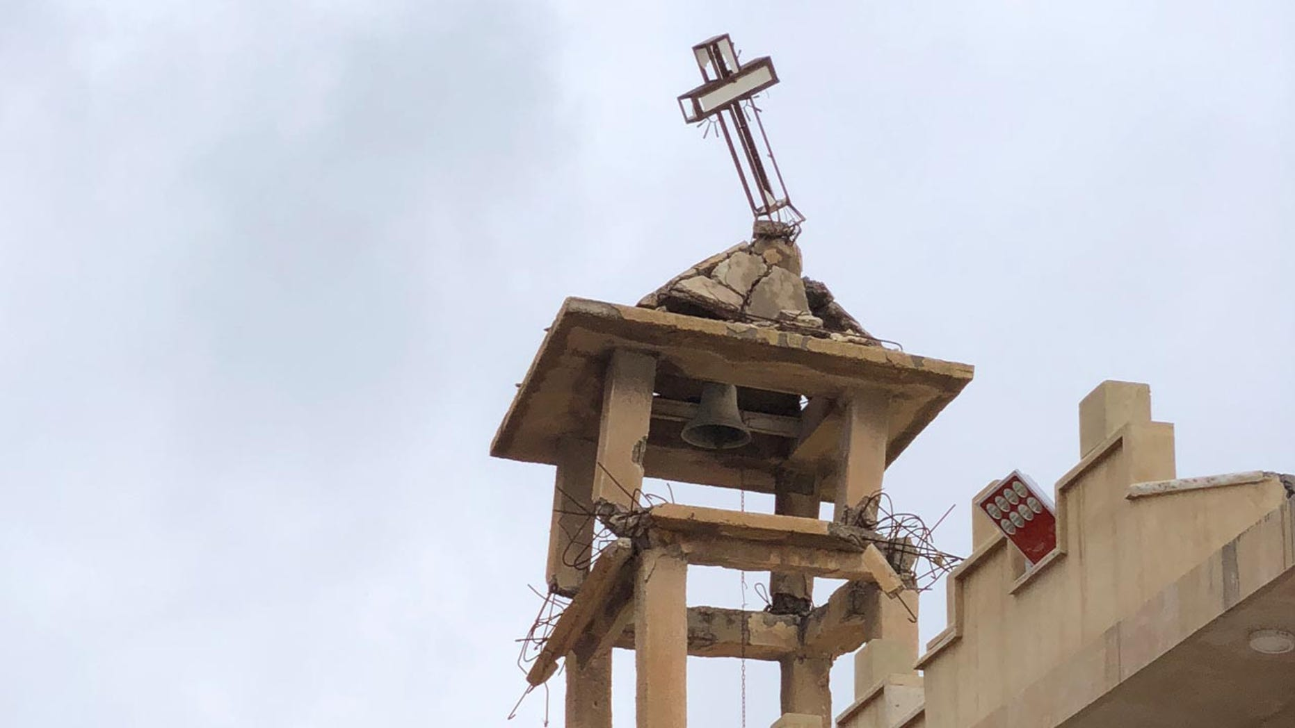 The bell tower ofSt. Adday Church in Karamles, a town the Knights of Columbus helped rebuild. The crooked cross is still standing despite the demotion of ISIS in the region.
