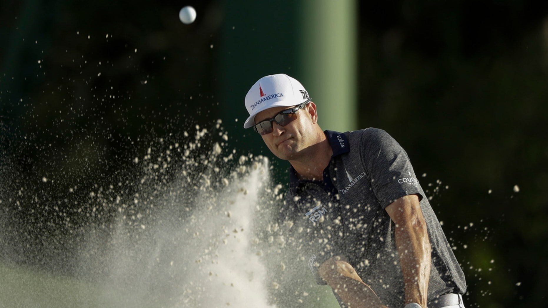 Zach Johnson hits on the 18th hole on Thursday during the first round for the Masters golf tournament in Augusta, Ga. (AP Photo/Marcio Jose Sanchez)