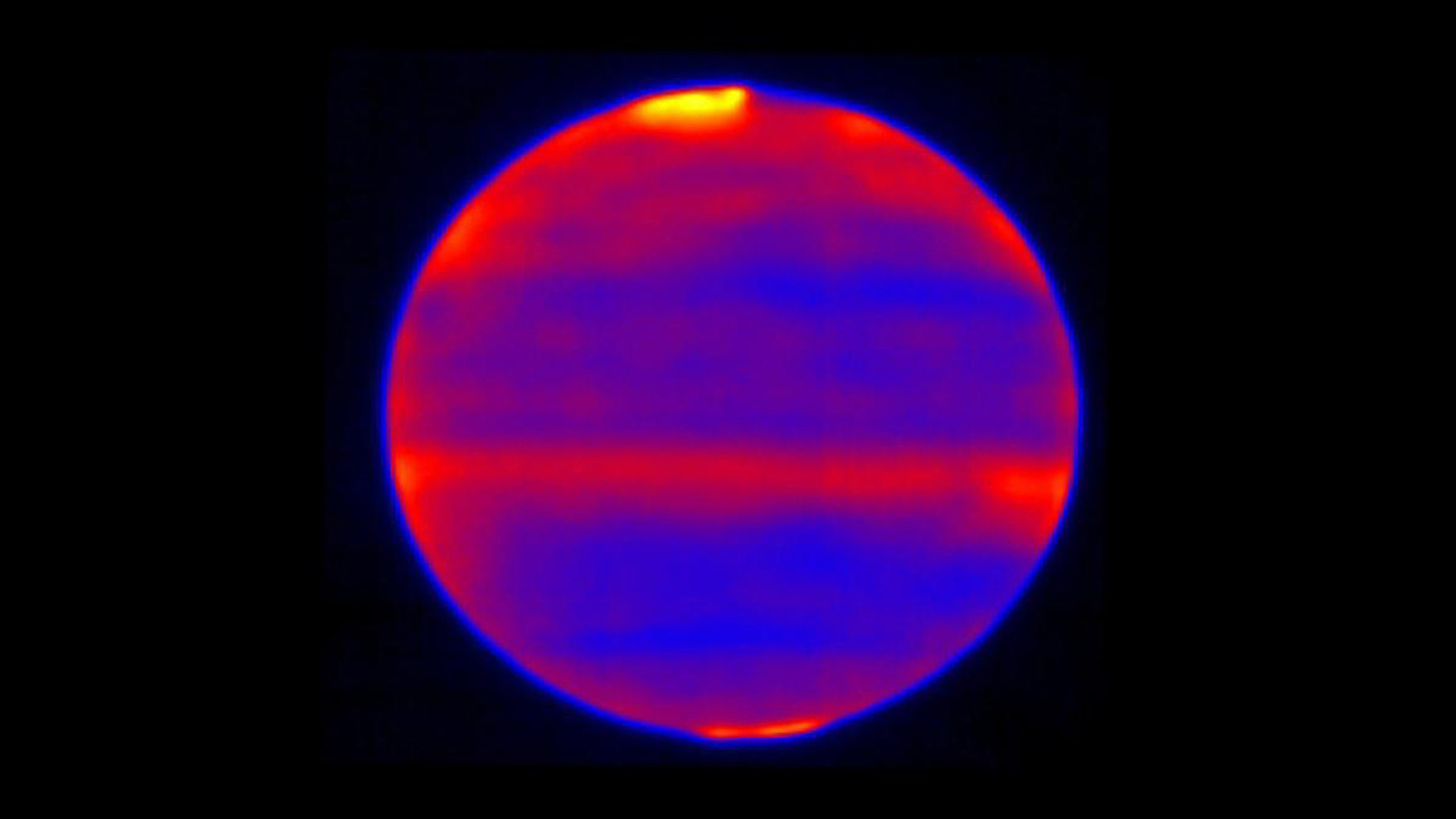 Scientists used red, blue and yellow to infuse this infrared image of Jupiter's atmosphere (red and yellow indicate the hotter regions), which was recorded by the Cooled Mid-Infrared Camera and Spectrograph (COMICS) at the Subaru Telescope on the summit of Mauna Kea, Hawaii on Jan. 12, 2017. (Credit: NAOJ and NASA/JPL-Caltech)