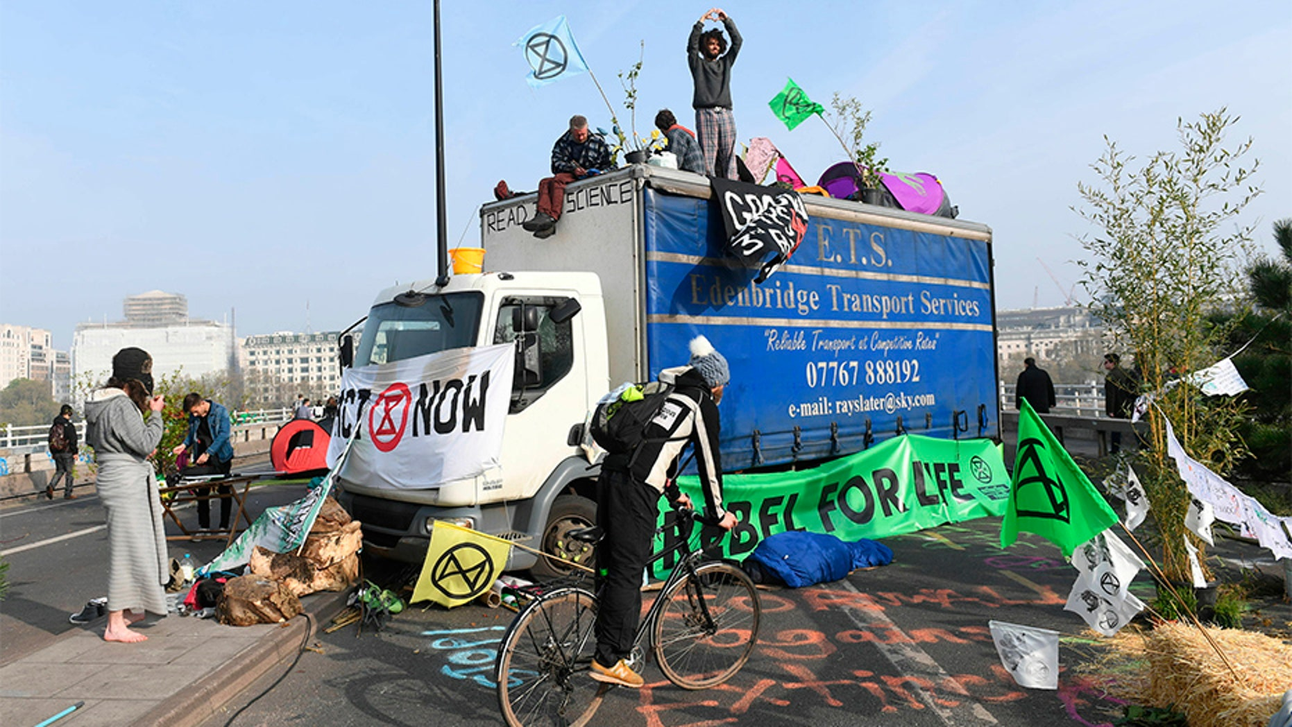 Extinction of the Rebellion Climate change protesters block Thursday's Waterloo Bridge, a major commuter road in London.