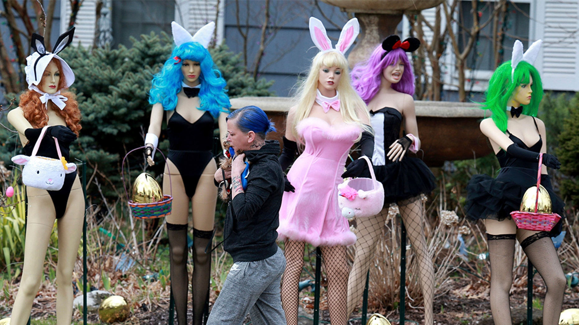 A New Jersey woman unhappy with her neighbor's racy Easter display used some garden shears to damage it. But the display's owner says it will soon be back up. The display has drawn mixed reviews from neighbors, as well as passers-by who stopped to take photos. ( Ed Murray/NJ Advance Media via AP)