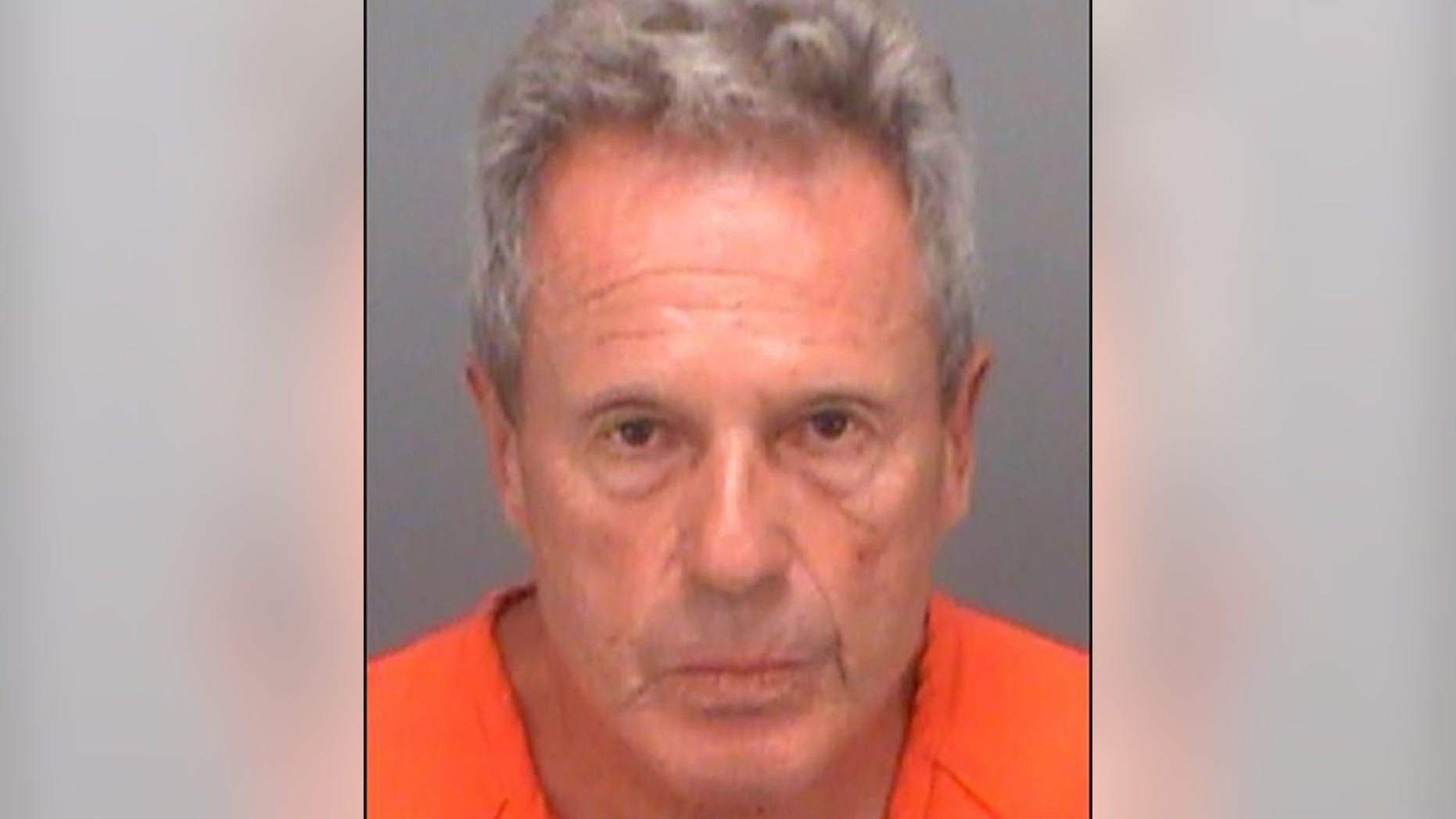 Joel William Benjamin, 71, was arrested for allegedly using a water gun to shoot his own bodily fluids at a woman walking her dog.