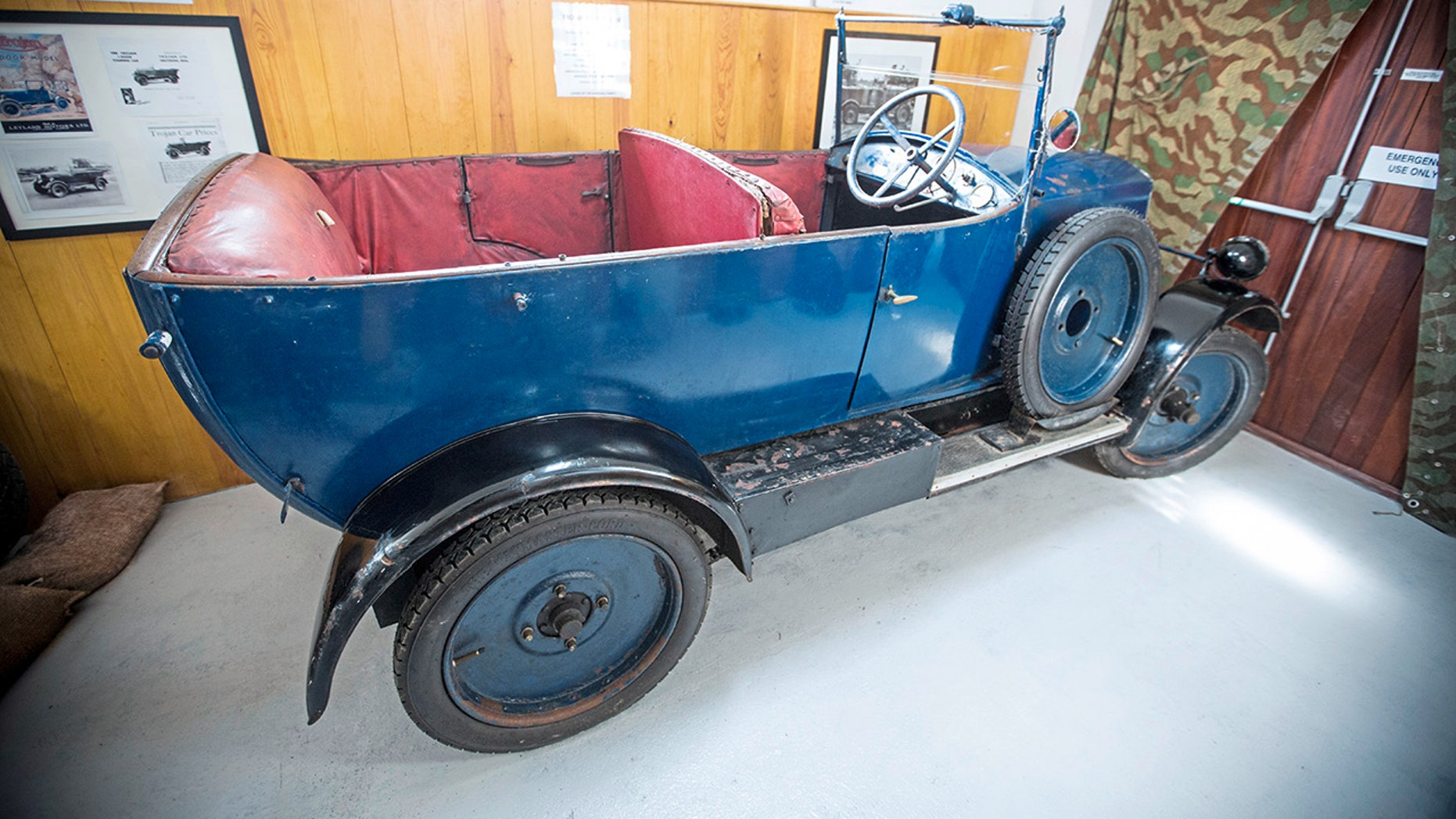 The 1926 Trojan Tourer was successfully hidden inside a vinery shed during WWII after the Germans banned all cars for private use. Cars seized on the island were requisitioned for as little as £1 and moved to France.