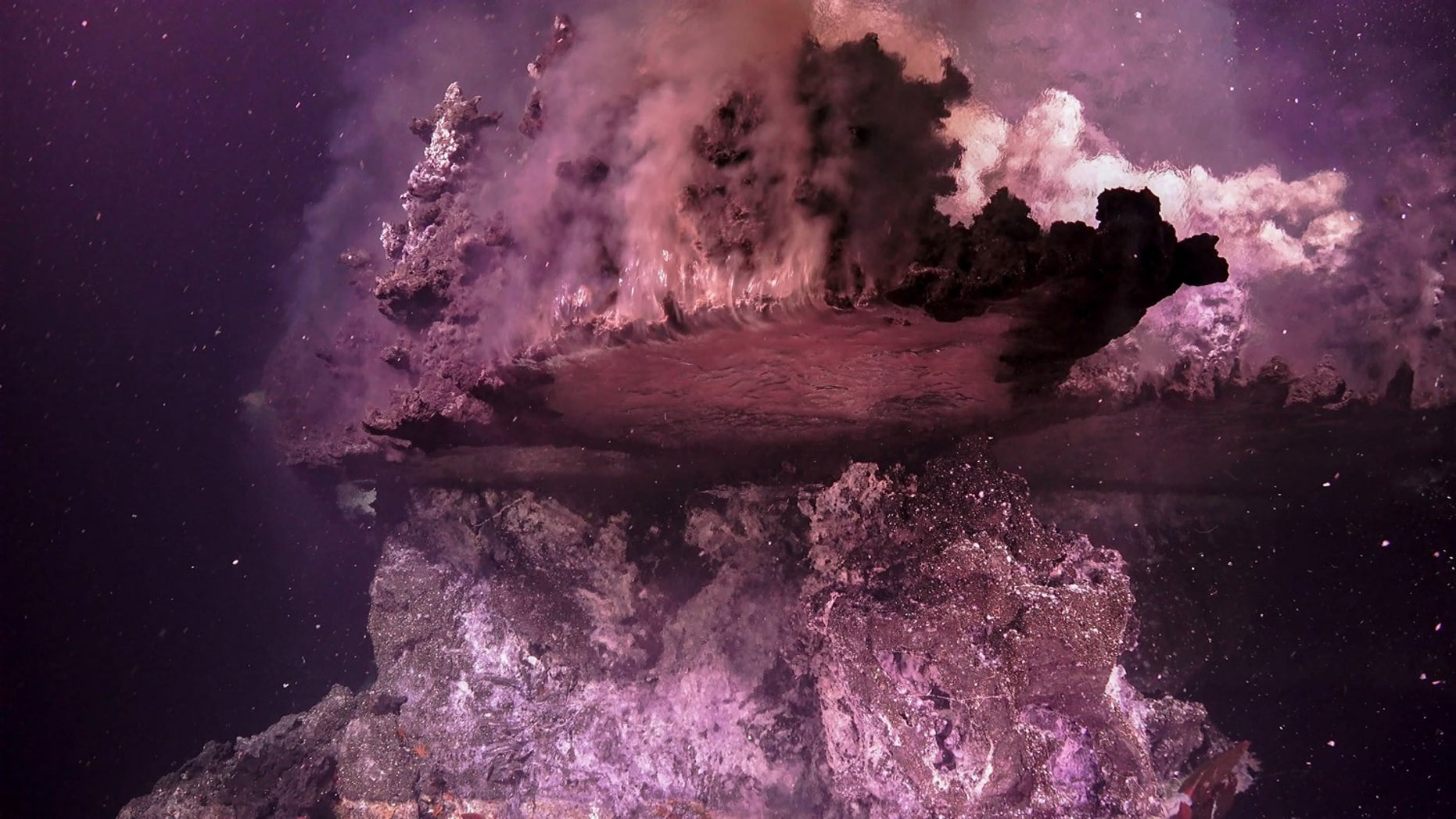 Hydrothermal fluid bubbles upward, gets trapped by a mineral ledge, and spills up and over the edge.