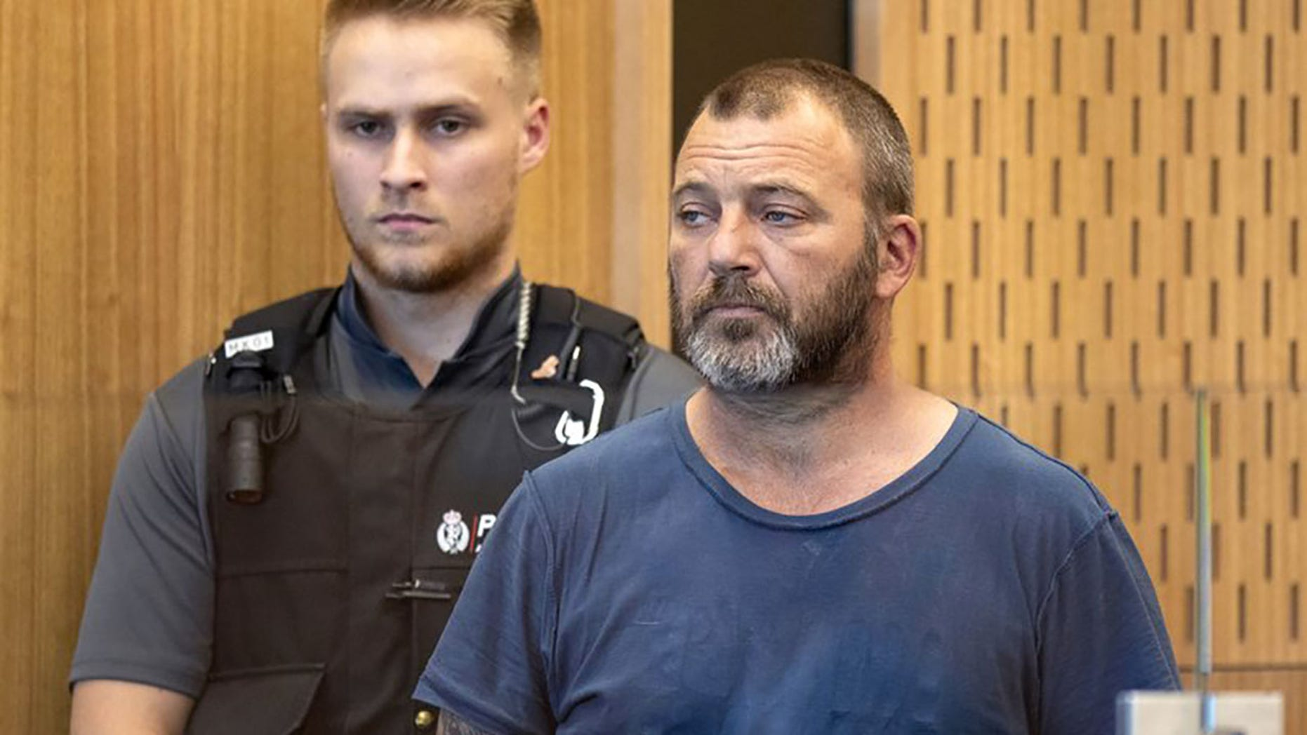 Philip Arps stands in the dock at the District Court in Christchurch, New Zealand on March 20. Arps has pleaded guilty to sharing a livestream video that was recorded by a gunman as he began killing 50 people at two mosques in New Zealand and will remain in jail until he's sentenced on June 14.<br>