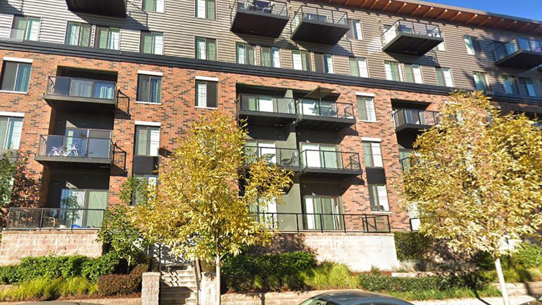 The little boy fell from the top floor of this Redmond apartment building Wednesday.