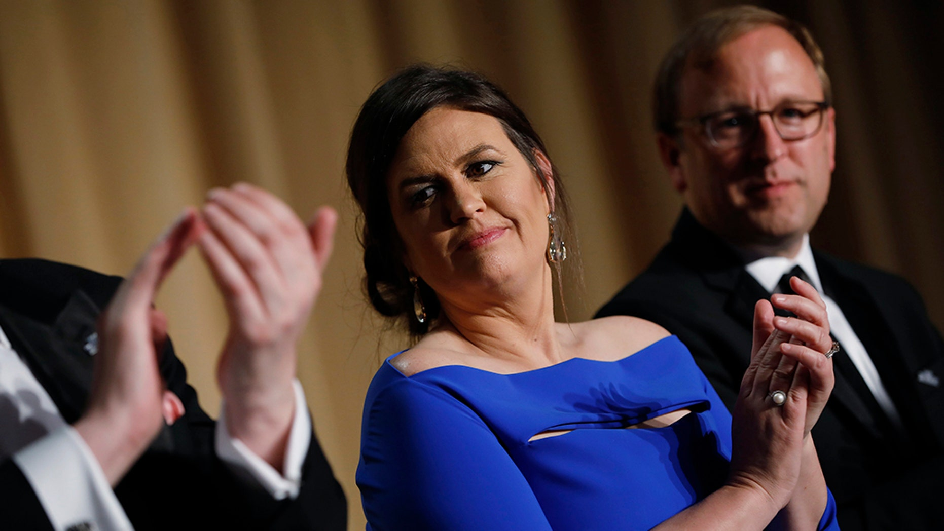 White House Press Secretary Sarah Huckabee Sanders is seen at the White House Correspondents' Association dinner in Washington, U.S., April 28, 2018. REUTERS/Aaron P. Bernstein - HP1EE4U104CHW