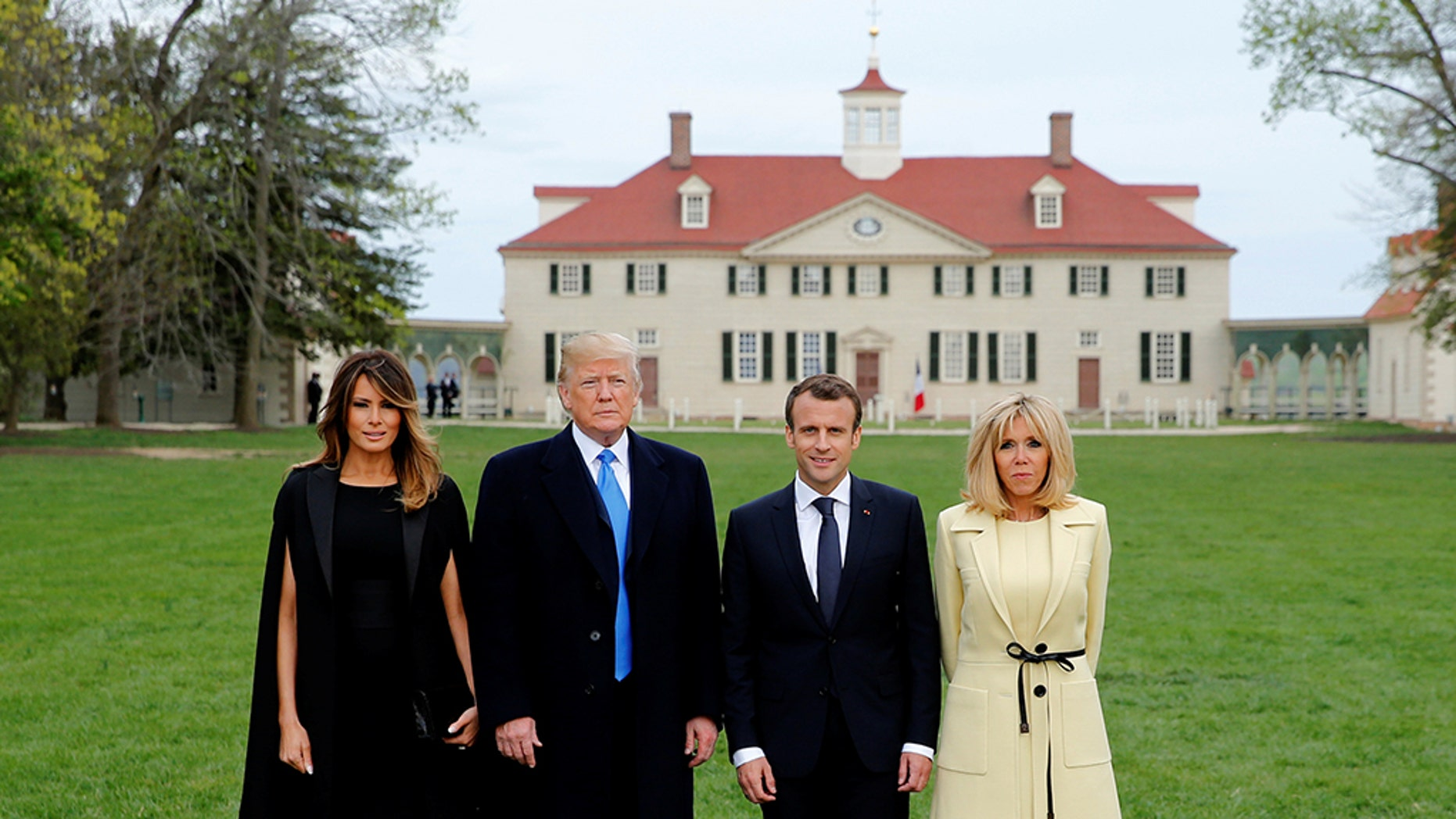 President Donald Trump and first lady Melania Trump and French President Emmanuel Macron and Brigitte Macron pose in front of Mount Vernon, on April 23, 2018.