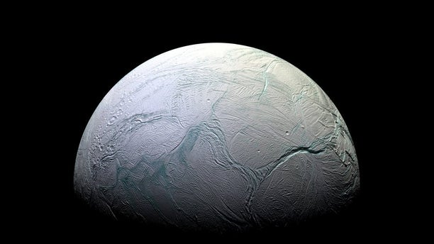 A view of Saturn's moon Enceladus taken by NASA's Cassini spacecraft. New models help explain why this moon ended up with a subsurface ocean while others nearby didn't.