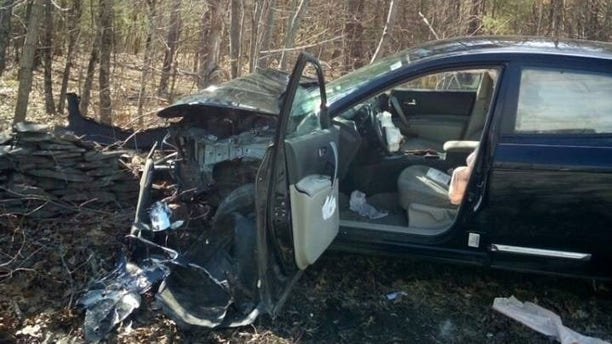 A woman in New York crashed her car and injured her leg after spotting a spider in the driver's area, police said.