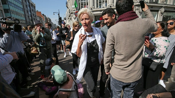 Actress Emma Thompson, center, joins Extinction Rebellion demonstrators causing disruption at the major road junction Oxford Circus in central London, Friday, April 19, 2019. The pressure group Extinction Rebellion is calling for continuing civic disobedience to demand government action on climate change.