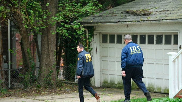 Federal Bureau of Investigation, and Internal Revenue Service agents search the home of Baltimore Mayor Catherine Pugh in Baltimore, MD., Thursday, April 25, 2019. Agents with the FBI and IRS are gathering evidence inside the two homes of Baltimore Mayor Catherine Pugh and in City Hall.