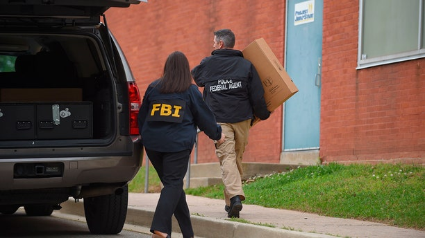 Federal agents arrive at the Maryland Center for Adult Training in Baltimore. MD, Thursday, April 25, 2019. Agents with the FBI and IRS are gathering evidence inside the two homes of Baltimore Mayor Catherine Pugh and in City Hall, as well as the office of her lawyer and the home of a top aide.