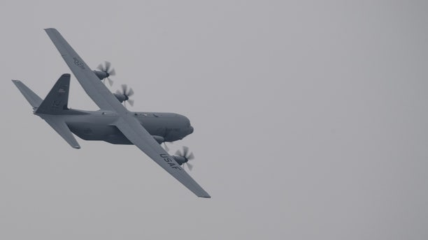 File photo - a C-130J Super Hercules with the 36th Airlift Squadron flies over Yokota Air Base, Japan, March 6, 2016.