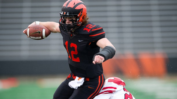Princeton QB John Lovett (12) attempts to avoid a tackle on a carry in the first half during the game between the Cornell Big Red and Princeton Tigers on October 27, 2018 at Princeton Stadium in Princeton, NJ.