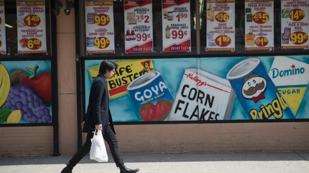 FILE- In this March 27, 2019, file photo a man leaves a supermarket in the East Village neighborhood of Manhattan carrying his groceries in a plastic bag. On Wednesday, April 10 the Labor Department reports on U.S. consumer prices for March. (AP Photo/Mary Altaffer, File)