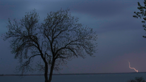A thunderstorm moves across John Redmond Reservoir near Burlington, Kan., Wednesday, April 17, 2019. Several thunderstorms turned severe as they moved through the area. (AP Photo/Orlin Wagner)