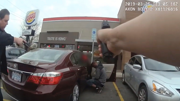 In this frame grab from a Charlotte-Mecklenburg Police Department officer body camera released Monday, April 15, 2019, shows two officers approaching 27-year-old Danquirs Napoleon Franklin outside a Burger King on March 29, 2019 in Charlotte, NC. Franklin was shot and killed. (Charlotte-Mecklenburg Police Department via AP)