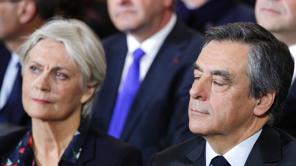FILE - In this Jan. 29, 2017 file photo, conservative presidential candidate Francois Fillon and his wife Penelope attend a campaign meeting in Paris. A French judicial official says investigating judges have requested that former Prime Minister Francois Fillon and his wife stand trial on corruption charges. (AP Photo/Christophe Ena, File)