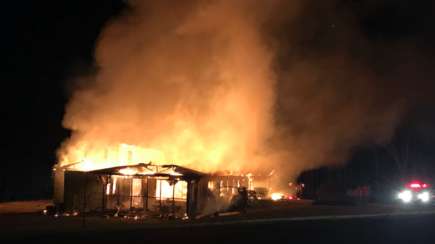 This Friday, March 29, 2019, photo provided by the New Market Fire and Rescue Team shows a fire at the main offices of the Highlander Education and Research Center in New Market, Tenn. The center is a social justice center that trained the Rev. Martin Luther King Jr. and other civil rights leaders. Representatives of the center said Tuesday, April 2, 2019, that a white power symbol was also found spray painted on the parking lot near the building. (Sammy Solomon/New Market Fire and Rescue Team via AP)